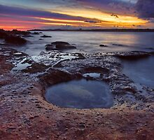 Rockpool sunset by Kounelli