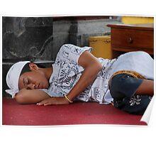Balinese boy sleeping on a temple pagoda  Poster