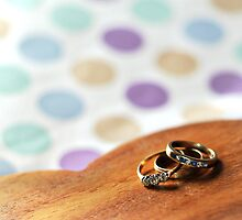 Rings on a wooden heart by EssjayNZ
