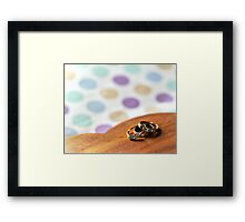 Rings on a wooden heart Framed Print