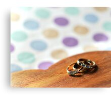 Rings on a wooden heart Canvas Print