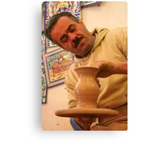 A Potter at Work Canvas Print