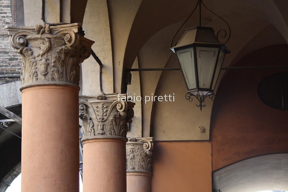three columns and a streetlight by fabio piretti