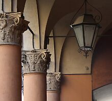 three columns and a streetlight by fabio piretti
