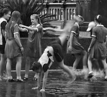 Girls Playing in Puddles by Andrew  Makowiecki