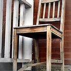 Old Wooden Chair on the Porch by M Sylvia Chaume