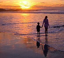 Wading in sunset bay - Carmel Beach, CA by Colleen Marquez