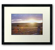 Sunset thorugh farm fence bokeh Framed Print