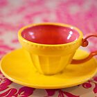 Yellow teacup by Zoe Power