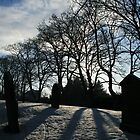 long shadows in the snowy churchyard by Breo
