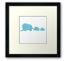 Elephant family following each other Framed Print