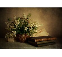 Still life with old books and white flowers in the basket Photographic Print