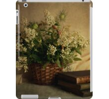 Still life with old books and white flowers in the basket iPad Case/Skin