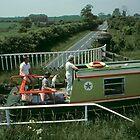 Narrow boat crossing Stretton Aqueduct, UK. by David A. L. Davies