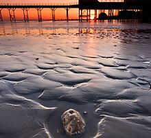 The stone and the pier at sunset by postmansmith