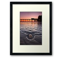 The stone and the pier at sunset Framed Print