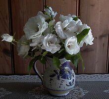 crisp white iceberg roses in Italian wine jug by BronReid