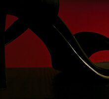 Heels and red light by Yannik Hay