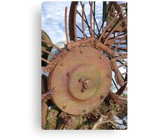 Rusty, abandoned farm equipment in the snow Canvas Print