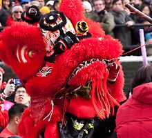 Picking the Green:  Lion Dancer at Lunar New Year Festival New York City by Dave Bledsoe