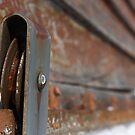 Rusted Garage Door Pulley Wheel by Casey Voss