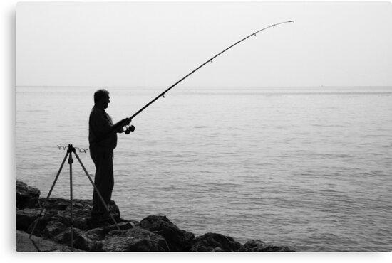 Sea fishing off the rocks by Paul Pasco