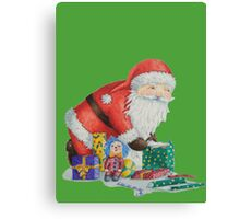Cute santa and toys wrapping Christmas gifts Canvas Print