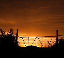 Orange Clouds and a gate silhouette by Qnita