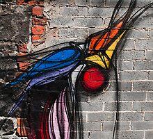 Graffiti Bird on Red and Grey Brick Wall by JohnKarmouche