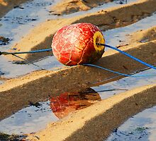 Red buoy on a Bali Beach by Michael Brewer