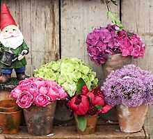 Still Life with Flowers & a Gnome by Ludwig Wagner