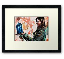 Clara Oswald and The Tiny TARDIS Framed Print