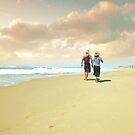 Walking in Huntington Beach by Carlos Casamayor