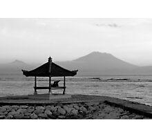 Lone figure in beachside pagoda, sacred mountain Gunung Agung in background. Bali, Indonesia Photographic Print