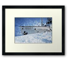 Boat on the rocks Framed Print