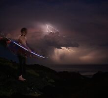 Surfer in a storm by Duncan Macfarlane