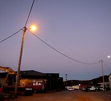 Moon Poses As Street Lamp by Jean Gregory  Evans