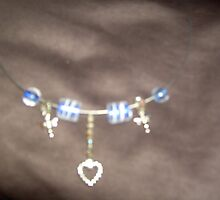 Danglin Heart and DragonFlies to catch the light with specialised beads by anaisnais