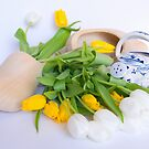 Dutch wooden clogs with spring flowers. by PhotoGrafin