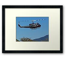 Huey Helicopter in motion Framed Print