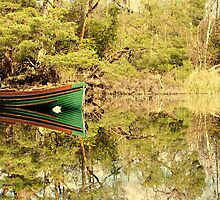 Boat Reflected on a calm lake by amuigh-anseo