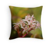 a floral bokeh Throw Pillow