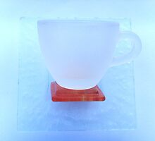 Glass coffee cup and saucer by Carol Dumousseau