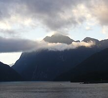 Low clouds- Milford Sound N Z by Christine Keech