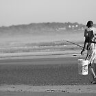 Fisherman walking - Arrawarra Beach by Peter Walton