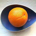 Orange in Blue Bowl by Victoria McGuire