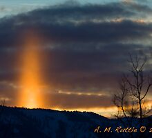 Rare Sun Pillar Over Teton Pass, Wyoming by A.M. Ruttle