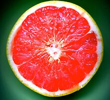 The colors of grapefruit and a green bowl by kgphoto