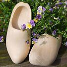 Dutch traditional wooden shoes.  by PhotoGrafin