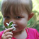  A Little Girl and One Flower  by Evita